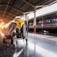 featured photo - luggage on a cart in front of a train
