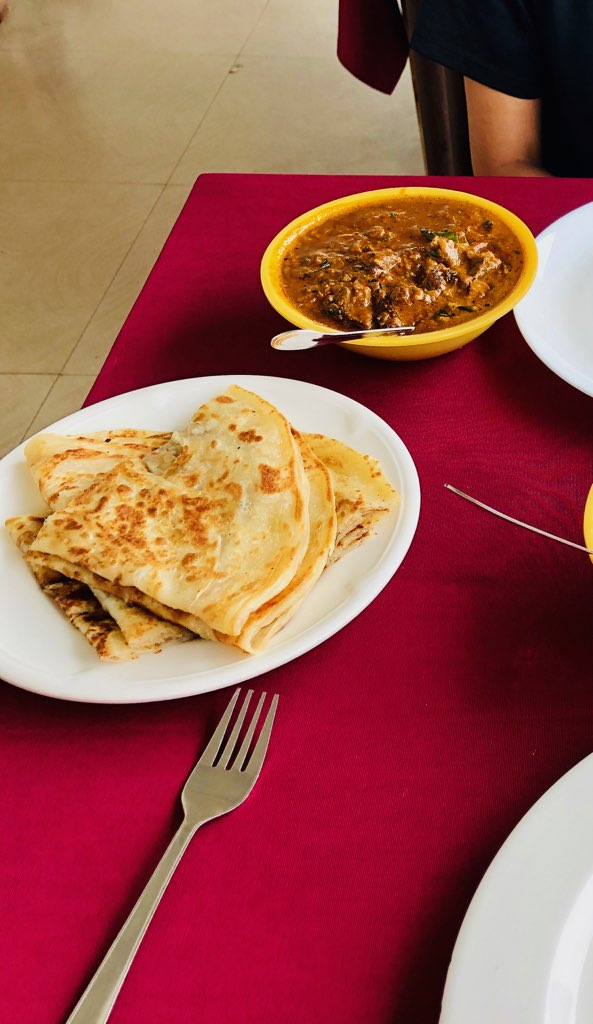 A photo of beef curry and parotta