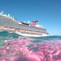 featured image for this post - a photo of a cruise ship taken from the water.