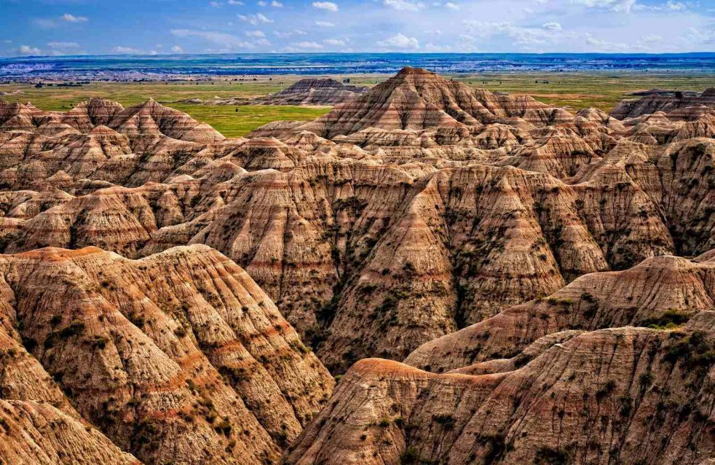 The list of underrated destinations in the USA include Badlands National Park.