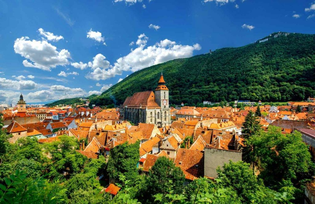One of the best cities to visit in Europe is Brasov.