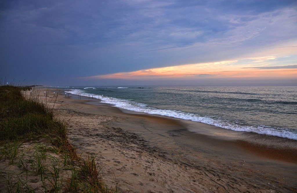 Add Cape Hatteras National Seashore is one of many amazing national parks on the East Coast.