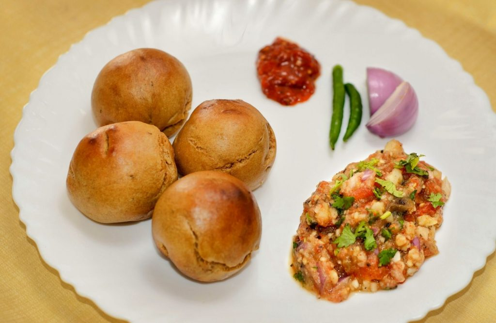 Be sure to try Litti Chokha which is a yummy Indian street food dish.