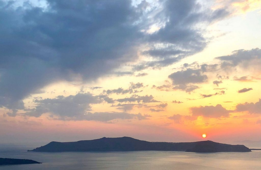 You'll definitely find better sunsets in Santorini than Mykonos!